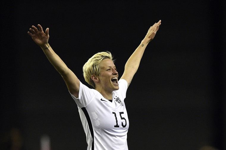USA midfielder Megan Rapinoe celebrates after winning the semi-final football match between USA and Germany during their 2015 FIFA Women's World Cup at the Olympic Stadium in Montreal on June 30, 2015. (Photo by Franck Fife/AFP/Getty)