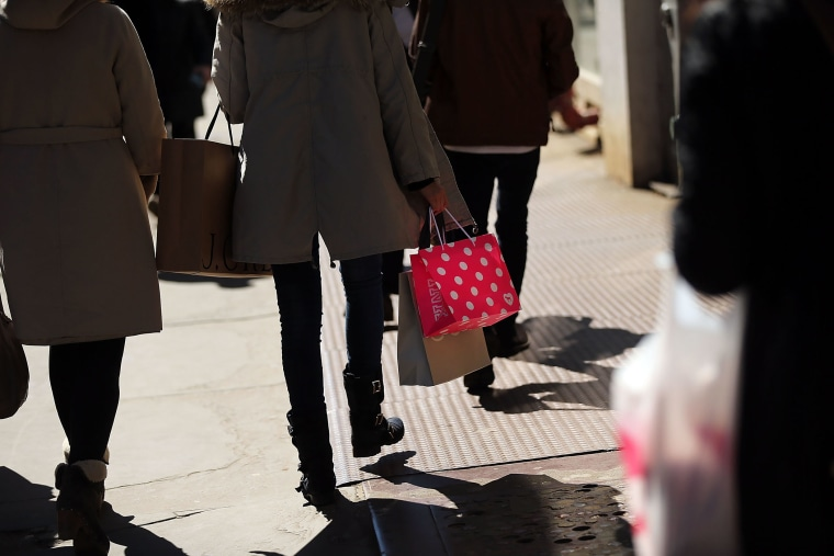 People walk with shopping bags in Manhattan on March 12, 2015 in New York, N.Y. (Photo by Spencer Platt/Getty)
