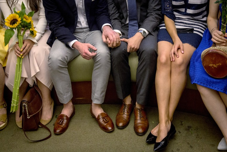 Ashby Hardesty (2nd L) and Rodrigo Zamora (C) hold hands as they wait with friends for their wedding ceremony at the New York City clerk's office in Manhattan, N.Y., June 26, 2015. (Photo by Brendan McDermid/Reuters)