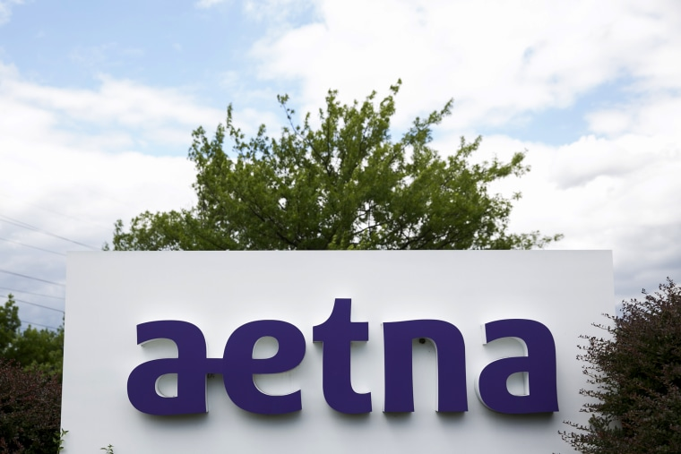 A logo sign outside of a facility occupied by Aetna, Inc., in Blue Bell, Penn., on June 28, 2015. (Photo by Kristoffer Tripplaar/AP)