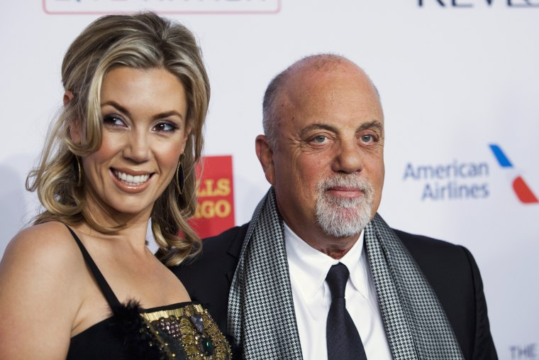 "Alexis Roderick and singer Billy Joel arrive at the Elton John AIDS Foundation's 12th Annual ""An Enduring Vision"" benefit gala at Cipriani in N.Y. on Oct. 15, 2013. (Photo by Eduardo Munoz/Reuters)"