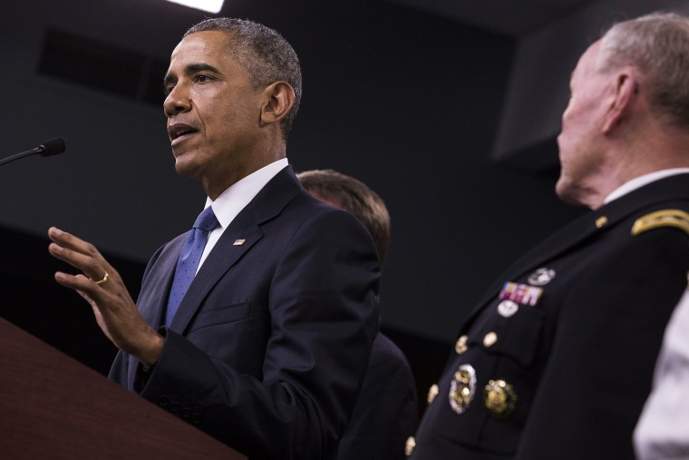 U.S. President Barack Obama, left, speaks during a news conference with General Martin Dempsey, chairman of the Joint Chiefs of Staff, at the Pentagon in Arlington, Va. on July 6, 2015. (Photo by Drew Angerer/Bloomberg/Getty)