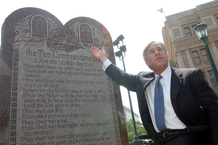 Texas Attorney General Greg Abbott attends a press conference celebrating the U.S. Supreme Court decision that allows a Ten Commandments monument to stand outside the Texas State Capitol in Austin, Texas on Jun. 27, 2005 (Photo by Jana Birchum/Getty).