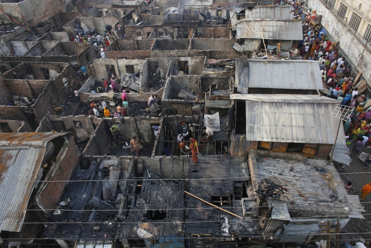 A general view of the wreckage of a slum from the top after a fire broke out, at Mirpur in Dhaka, Bangladesh on Feb. 11, 2014 (Photo by Andrew Biraj/Reuters).