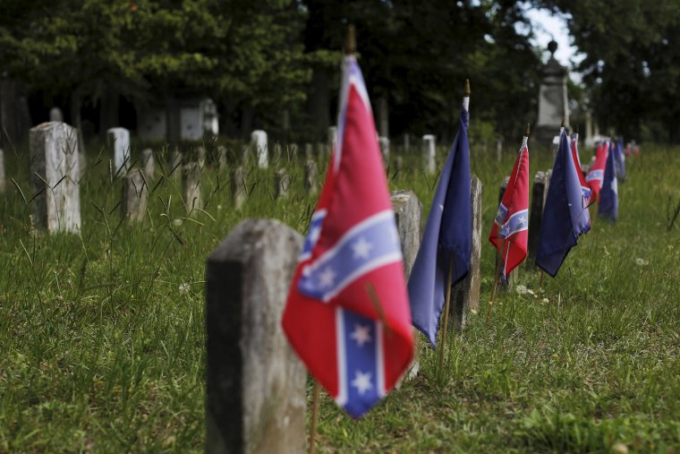 Confederate battle flags mark the graves of soldiers in the Confederate States Army in the U.S. Civil War in Magnolia Cemetery in Charleston