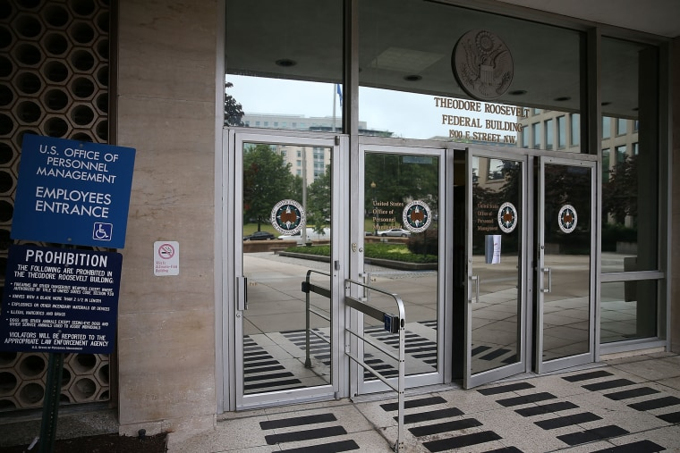 The entrance to the Theodore Roosevelt Federal Building that houses the Office of Personnel Management headquarters is shown June 5, 2015 in Washington, D.C. (Photo by Mark Wilson/Getty)