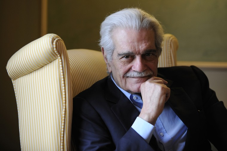 Egyptian actor Omar Sharif poses for a photograph at a hotel in Aviles, northern Spain