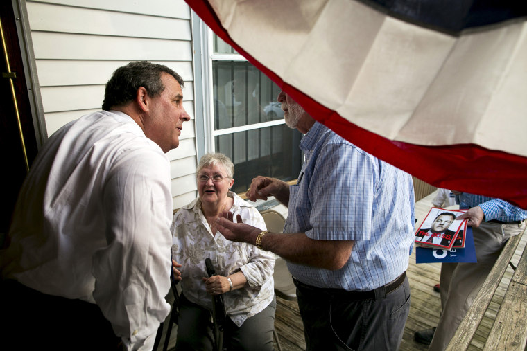 New Jersey governor and Republican presidential candidate Chris Christie speaks with supporters after a town hall event in Sandown