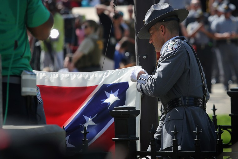 Confederate Flag removed from South Carolina Statehouse grounds on July 10, 2015 in Columbia, South Carolina (Photo by John Moore/Getty).