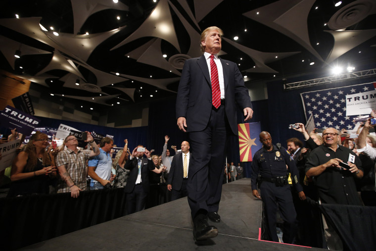 Republican presidential candidate Donald Trump walks on stage to speak before a crowd of 3,500 on July 11, 2015, in Phoenix, Ariz. (Photo by Ross D. Franklin/AP)