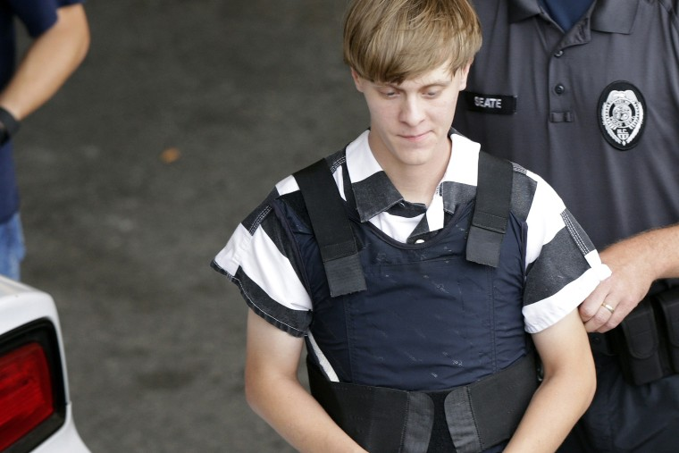 Dylann Storm Roof is escorted from the Cleveland County Courthouse in Shelby, N.C. on June 18, 2015. (Photo by Chuck Burton/AP)