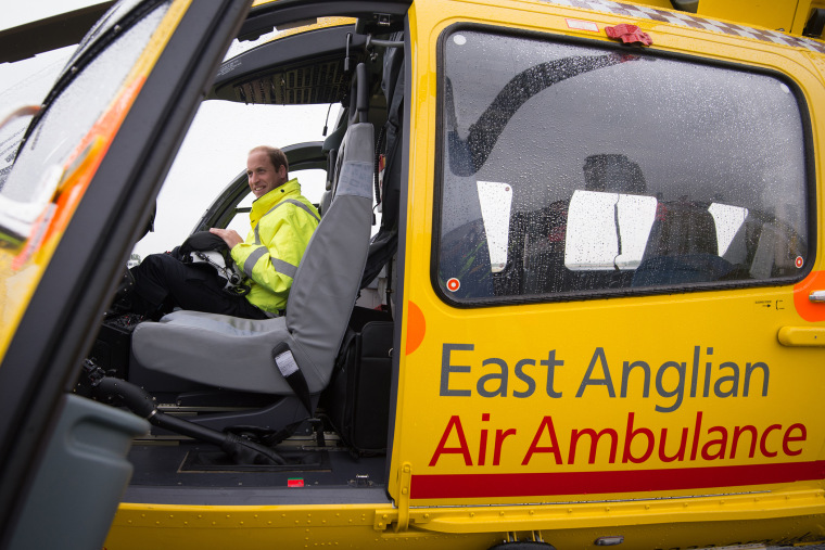 Prince William, The Duke of Cambridge sits in the cockpit of an helicopter as he begins his new job with the East Anglian Air Ambulance (EAAA) at Cambridge Airport on July 13, 2015 in Cambridge, England. (Photo by Stefan Rousseau/WPA/Pool/Getty)