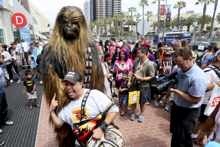 A man dressed as Chewbacca from Star Wars poses with fans outside of the 2015 Comic-Con International in San Diego, Calif. on July 9, 2015. (Photo by Sandy Huffaker/Reuters)