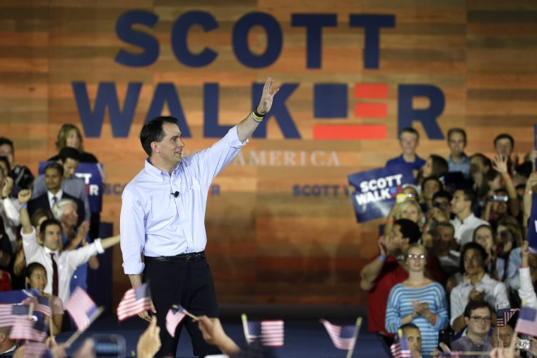 Wisconsin Gov. Scott Walker waves to supporters as he announces he is running for the 2016 Republican presidential nomination at the Waukesha County Expo Center on July 13, 2015, in Waukesha, Wis. (Photo by Morry Gash/AP)