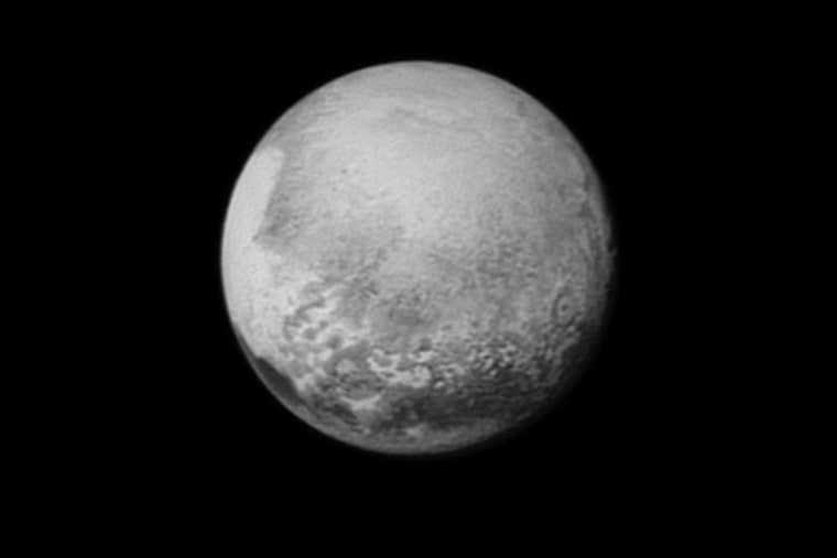 """Pluto's bright, mysterious """"heart"""" is rotating into view, ready for its close-up on close approach, in this image taken by New Horizons on July 12 from a distance of 1.6 million miles (2.5 million kilometers)."""