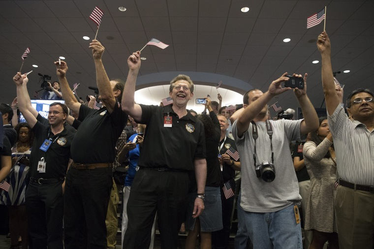 New Horizons spacecraft Pluto flyby (Photo by Michael Reynolds/EPA)