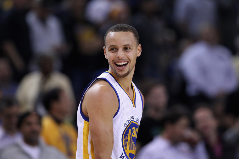 Stephen Curry #30 of the Golden State Warriors smiles during their game against the Indiana Pacers at ORACLE Arena on Jan. 7, 2015 in Oakland, Calif. (Photo by Ezra Shaw/Getty)