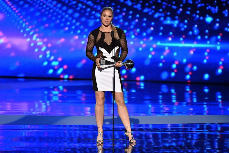 UFC fighter Ronda Rousey accepts the Best Female Athlete award onstage during The 2015 ESPYS at Microsoft Theater on July 15, 2015 in Los Angeles, Calif. (Photo by Kevin Winter/Getty)