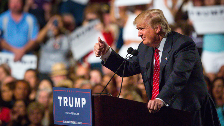 Republican Presidential candidate Donald Trump addresses supporters during a political rally at the Phoenix Convention Center on July 11, 2015 in Phoenix, Ariz. (Photo by Charlie Leight/Getty)