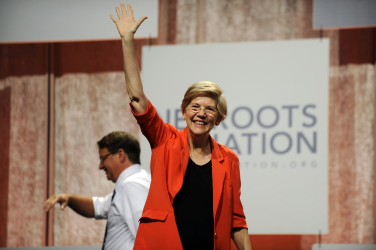 U.S. Sen. Elizabeth Warren, D-Mass., waves to the crowd after her introduction at the Netroots Nation conference in Detroit (Photo by David Coates/AP).