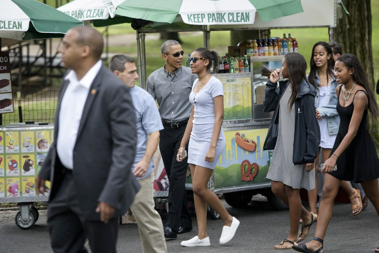 US President Barack Obama walks with daughters Sasha Obama (C) and Malia Obama (2R) and others in Central Park on July 18, 2015 in New York, N.Y. (Photo by Brendan Smialowski/AFP/Getty)