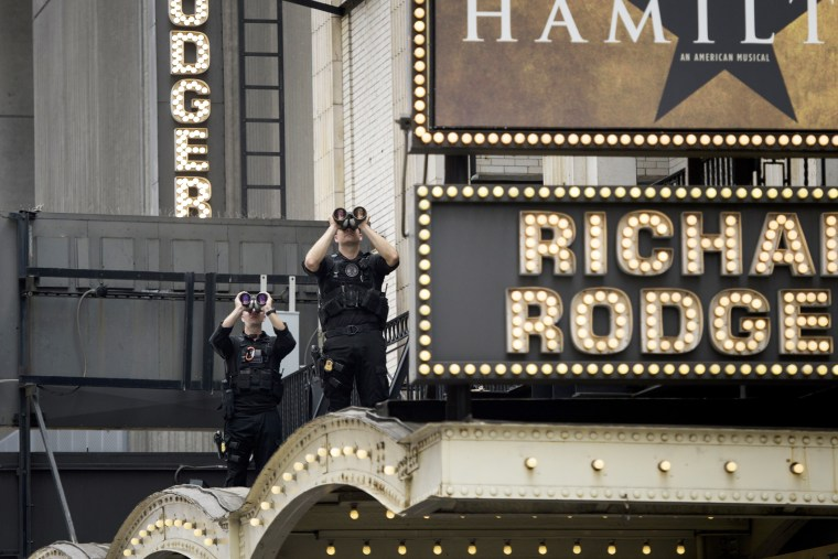 """Members of the Secret Service watch over the Richard Rodgers Theatre while US President Barack Obama attends a showing of \""""Hamilton\"""" with his daughters Sasha and Malia Obama on July 18, 2015 in N.Y. (Photo by Brendan Smialowski/AFP/Getty)"""