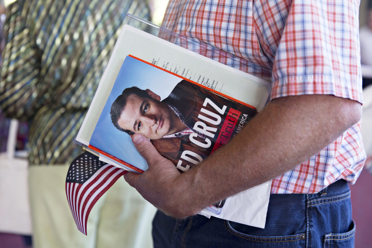 A guest holds a book by Senator Ted Cruz during The Family Leadership Summit in Ames, Iowa on July 18, 2015. (Photo by Daniel Acker/Bloomberg/Getty)