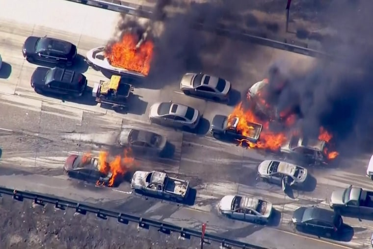 Cars are shown burning on the Interstate 15 freeway in the Cajon Pass, Calif. in the frame grab from KNBC video on July 17, 2015. (Photo by NBCLA.com/Reuters)