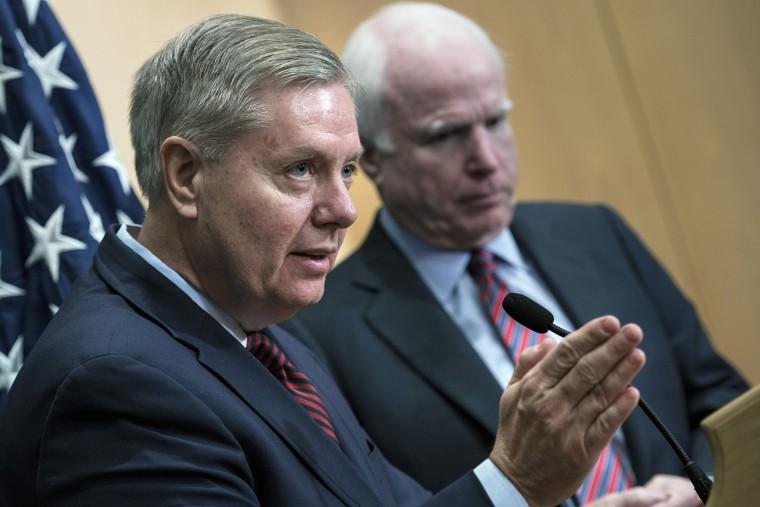Senator Lindsey Graham speaks near Senator John McCain during a press conference at the David Citadel hotel on Jan. 3, 2014. (Photo by Brendan Smialowski/AFP/Getty)