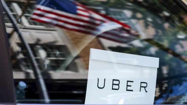 An Uber sign is seen in a car in N.Y. on June 30, 2015. (Photo by Eduardo Munoz/Reuters)