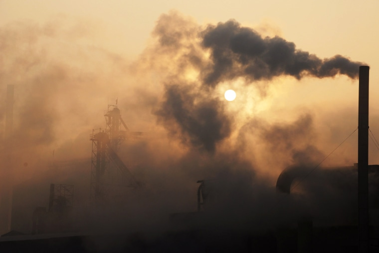 A cement factory releasing heavy smoke in Binzhou, in eastern China's Shandong province on Jan. 17, 2013. (Photo by STR/AFP/Getty)