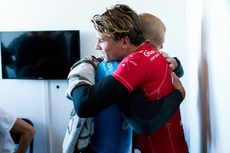 Mick Fanning and Julian Wilson (Photo by Kristen Scholtz/WSL/AFP/Getty)