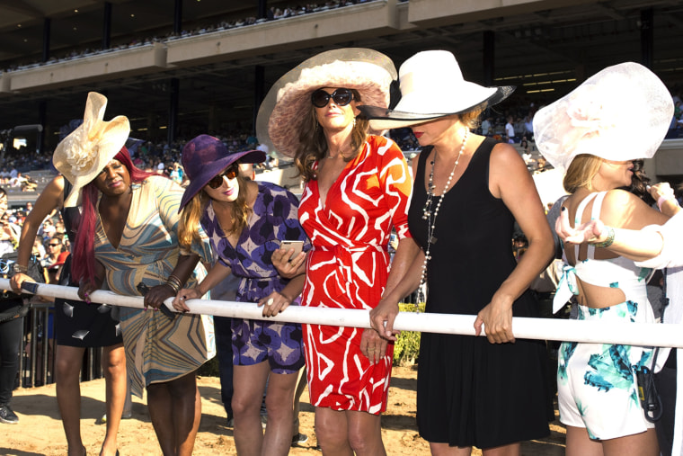 In a photo provided by Benoit Photo, Caitlyn Jenner, center, and friends are trackside to watch the seventh race, July 16, 2015 as the Del Mar Thoroughbred Club opened is annual summer meet in Del Mar, Calif.
