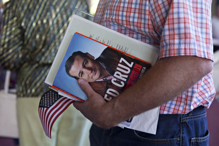 A guest holds a book by Senator Ted Cruz, a Republican from Texas and 2016 U.S. presidential candidate, during The Family Leadership Summit in Ames, Iowa, U.S., on July 18, 2015. The sponsor, The FAMiLY LEADER, is a 'pro-family, pro-marriage, pro-life organization which champions the principle that God is the ultimate leader of the family.'