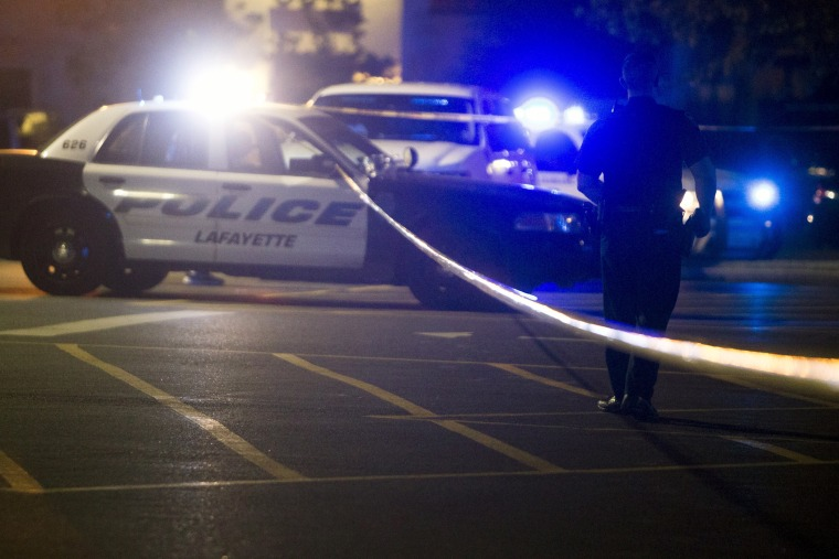 Police stand by at the scene outside the movie theatre where a man opened fire on film goers in Lafayette, La., July 23, 2015. (Photo by Lee Celano/Reuters)