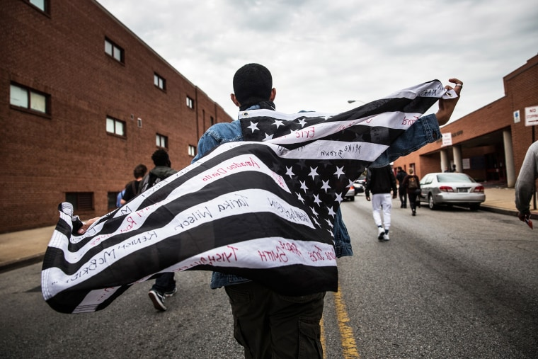 Protesters march through the streets on May 1, 2015 in Baltimore, Md., in reaction to the death of Freddie Gray. (Photo by Andrew Burton/Getty)