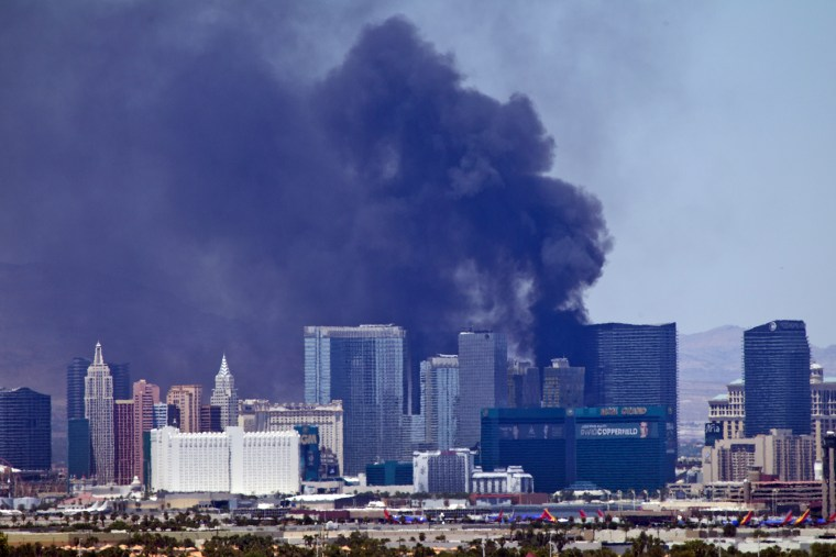 Smokes billows from a fire on the outside pool area of the Cosmopolitan Las Vegas hotel-casino in Las Vegas, Nev. on July 25, 2015. (Photo by Steve Marcus/Las Vegas Sun/AP)