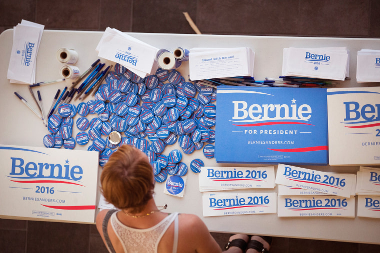 A supporter of Democratic presidential candidate Senator Bernie Sanders (I-VT) looks over campaign materials at a town hall meeting hosted by the candidate at Valley High School on July 24, 2015 in West Des Moines, Iowa. (Photo by Scott Olson/Getty)