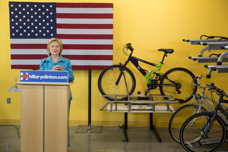 Democratic presidential hopeful Clinton talks about her environmental plan during a visit to the DART Central Station in Des Moines (Photo by Stringer/Reuters).