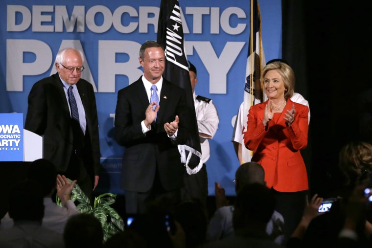 Democratic presidential candidates, Bernie Sanders, Martin O'Malley and Hillary Rodham Clinton during the Iowa Democratic Party's Hall of Fame Dinner, July 17, 2015, in Cedar Rapids. (Photo by Charlie Neibergall/AP)