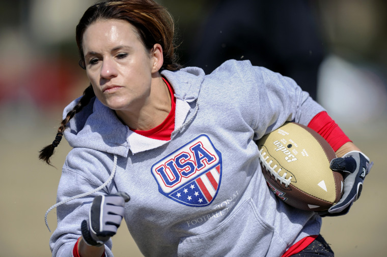 Jennifer Welter participates in a drill during practice, Feb. 13, 2014, in Allen, Texas. (Photo by Cal Sport Media/AP)