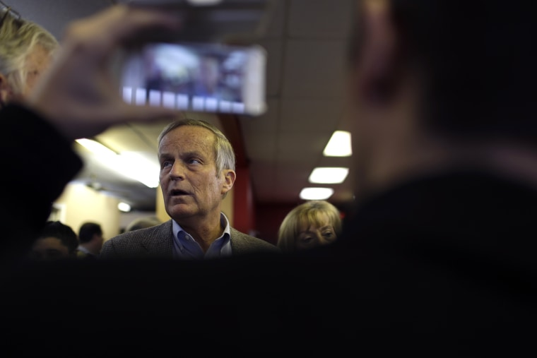 Then, Missouri Senate candidate, Rep. Todd Akin, R-Mo., visits with supporters during a stop to a Republican campaign office, Nov. 5, 2012, in Florissant, Mo. (Photo by Jeff Roberson/AP)