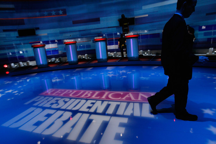 Workers prepare the stage for the GOP Presidential Candidates Debate (Photo by Joe Raedle/Getty).