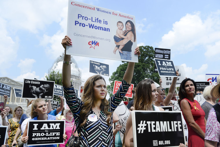 Anti-abortion activists hold a rally opposing federal funding for Planned Parenthood (Photo by Olivier Douliery/Getty).