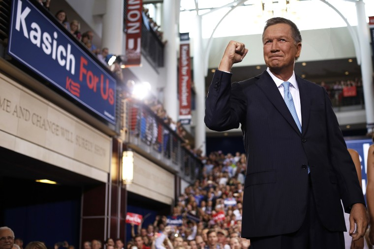 John Kasich, governor of Ohio, gestures while arriving to announce he will seek the 2016 Republican presidential nomination in Columbus, Ohio, on July 21, 2015. (Photo by Luke Sharrett/Bloomberg/Getty)