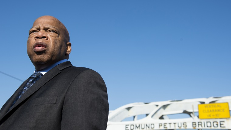 Rep. John Lewis, D-Ga., stands on the Edmund Pettus Bridge in Selma, Ala., in between television interviews on Feb. 14, 2015. (Photo by Bill Clark/CQ Roll Call/Getty).