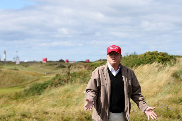 Presidential contender Donald Trump gestures to the media on the 17th fairway on the first day of the Women's British Open golf championship on the Turnberry golf course in Turnberry, Scotland, July 30, 2015. (Photo by Scott Heppell/AP)
