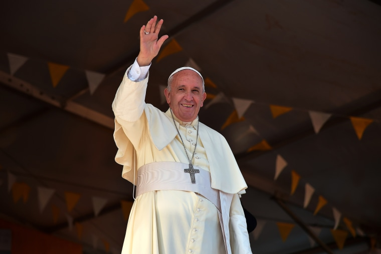 Pope Francis waves during a visit to the people of Banado Norte at the Chapel of Juan Bautista in Asuncion on July 12, 2015 (Photo by Vincenzo Pinto/AFP/Getty).