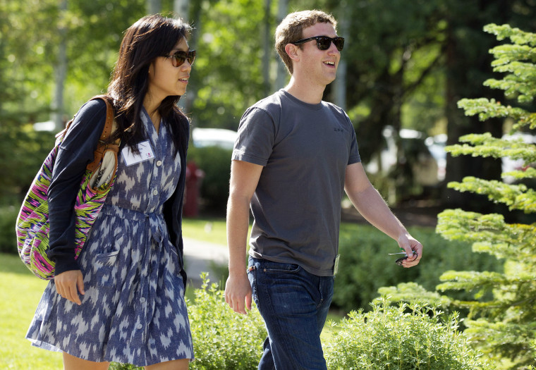Mark Zuckerberg and wife Priscilla Chan (Photo by Julie Jacobson/AP).