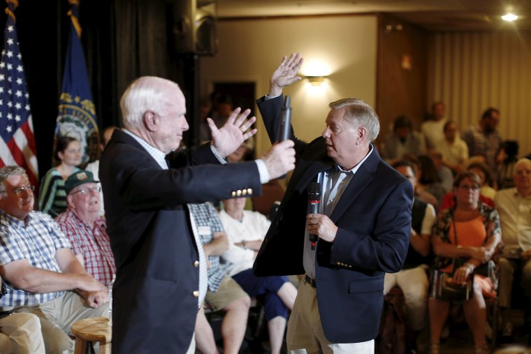 U.S. Republican presidential candidate Lindsey Graham gestures with Arizona Senator John McCain at a campaign town hall event in Manchester, N.H., Aug. 1, 2015. (Photo by Dominick Reuter/Reuters)